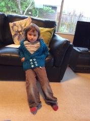 Luka models a blue cardi