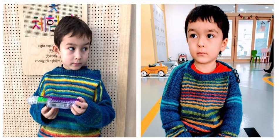two boys wearing colourful striped handknit jerseys